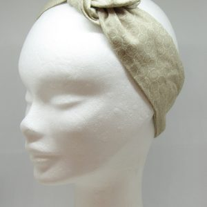Fascia sottile con ferretto cotone beige fantasia riccioli bianchi